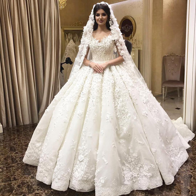c945744a921 Luxurious Arabic Dubai Ball Gown Wedding Gowns 3D Floral Appliques 2018 New Sexy  Off Shoulder Beaded Sequins Puffy Bridal Gowns