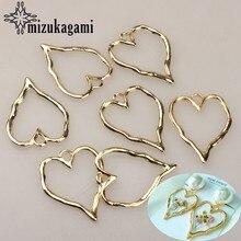 Nuevo 37*30mm 6 unids/lote de aleación de Zinc de oro hueco corazones encantos colgante de la joyería de moda DIY hacer pendientes Accesorios