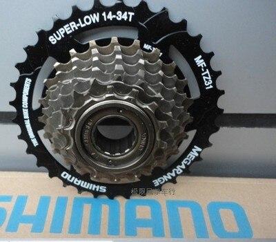 SHIMANO mountain bike TZ31 flywheel 7 speed positioning 14-34T mountain bike / folding bike flywheel rotating flywheel цена