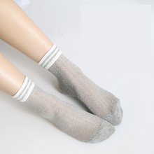 купить 2 Pairs/Lot Women socks spring/autumn Han edition stripe Hollow thin air breathable 2 bar ulzzang The original SuFeng  stocks по цене 335.55 рублей