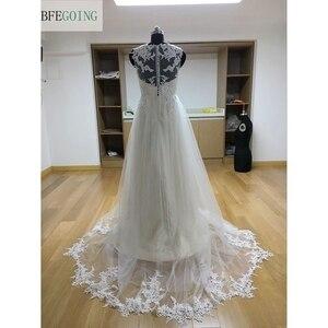 Image 2 - Ngà Tulle V Cổ Tầng Dài A Line Wedding dresses Chapel Train Không Tay Bridal Gown Custom made