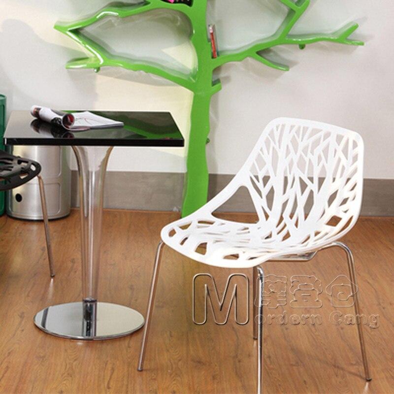 Modern magazijn plant een boom stoel eetkamerstoel doorboord opengewerkte minimalistische stijl - Moderne stijl lounge ...