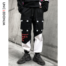 купить UNCLEDONJM Track Pants Man Color Block Pockets 2019 AW Hip Hop Fashion Harem Streetwear Fashion Jogger Casual Trousers 540W по цене 1880.29 рублей