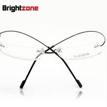 Retail 9 colors fashion rimless glasses frames/fashion memory titanium eyeglasses frames/prescription optical frames