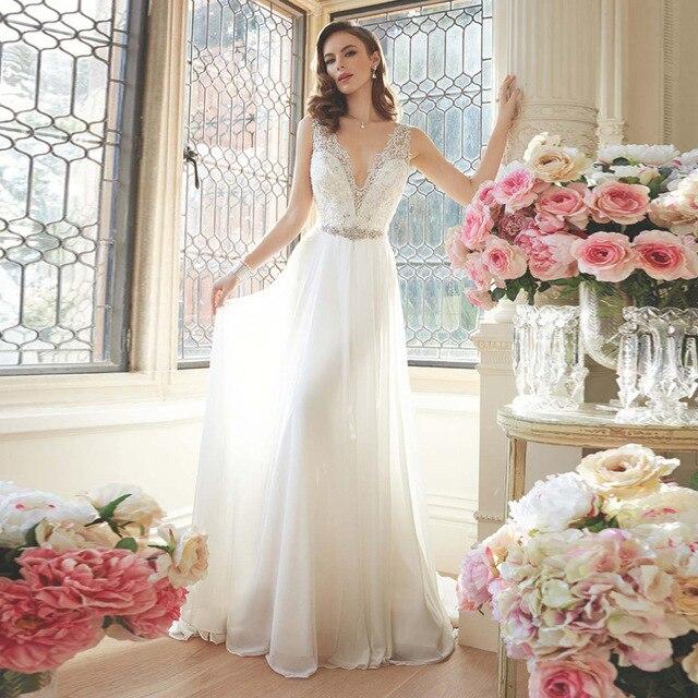 2017 Lace Appliques V-Neck Wedding Dress Crystals Bead Charming A-Line Bridal  Dress bdbfb80cc9d1