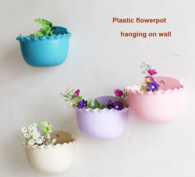 suspendre en plastique accroché au mur belle pots de fleurs fleur