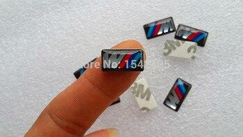 Miễn phí vận chuyển 100 cái/lốc Mới phong cách Xe M nhỏ Trang Trí Huy Hiệu Hub caps Chỉ Đạo bánh xe Xe Biểu Tượng Nhãn Dán xe ngẫu nhiên sticker