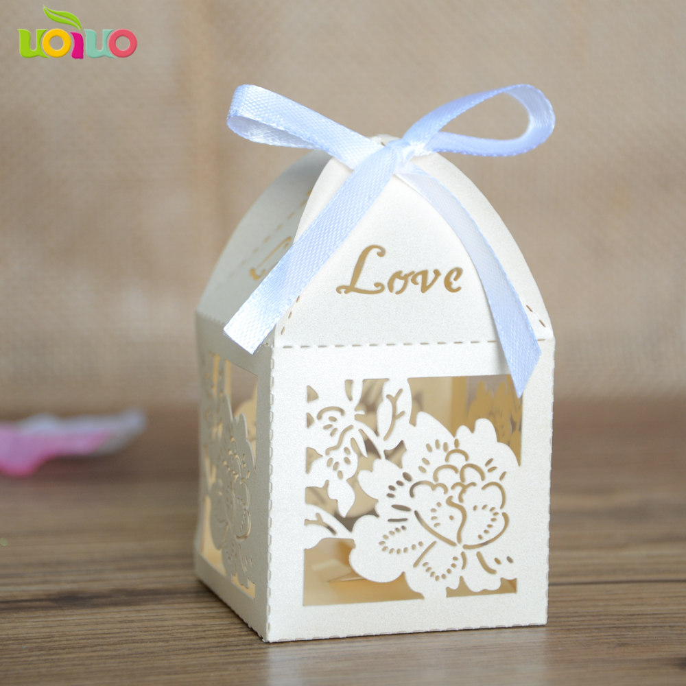 Cream color wedding gift box with ribbon and flower design wedding ...