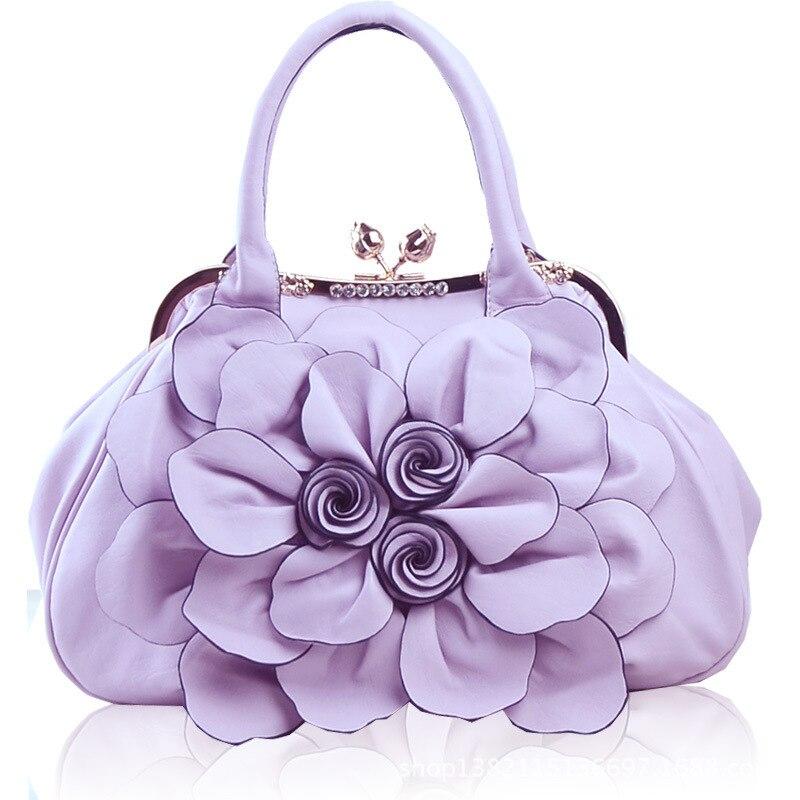New vintage handbags handbags high-grade PU material quality costs in a messenger bag shoulder bag personality flowers bag