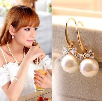 Exquise mode haute qualité zircon boucles d'oreilles imitation strass perle arc pendentif boucles d'oreilles en gros