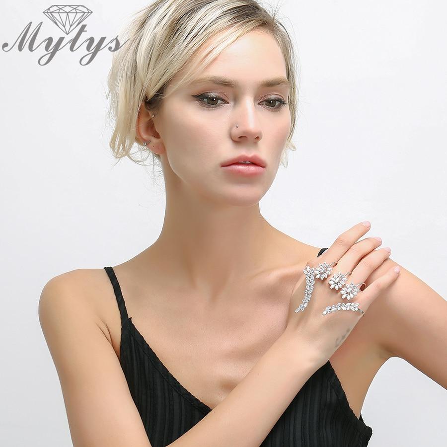 все цены на Mytys Plant Design Crystal Flower Leaf Palm Bracelet Silver Color Hand Palm Jewelry New Trendy Handlets For Women R1116