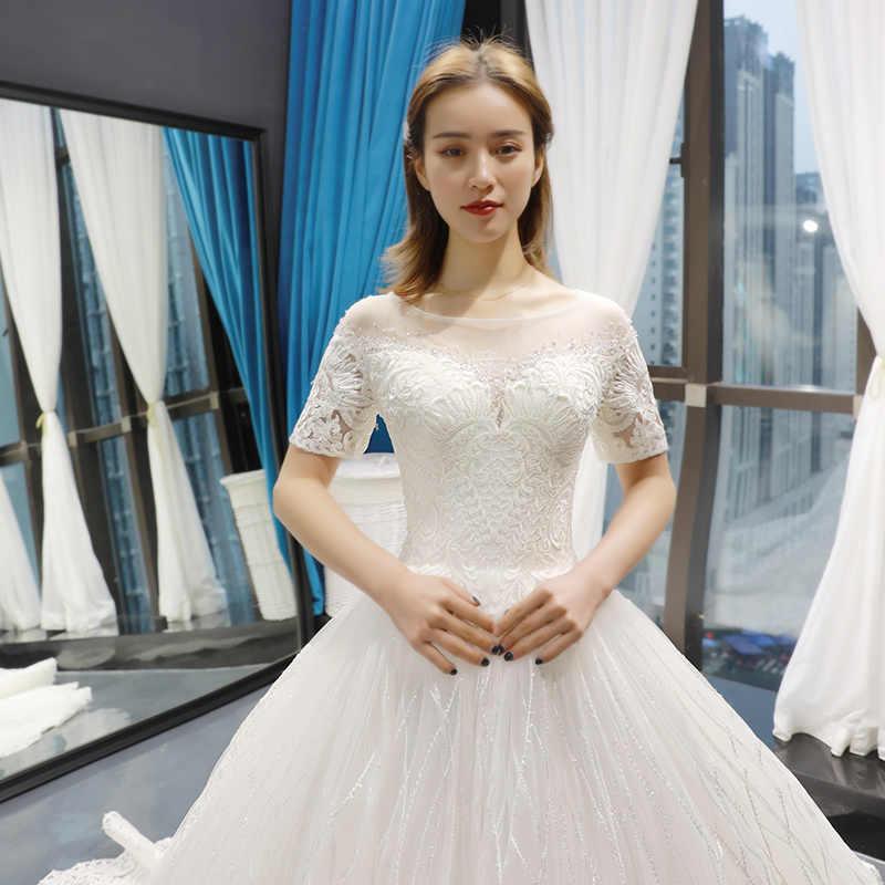 J66769 jancember suknia balowa suknie ślubne dla panny młodej z krótkim rękawem z krótkim rękawem aplikacje lace up suknie ślubne vestido de noiva praia