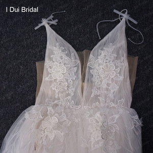 Image 5 - Split Leg Wedding Dress Short Inside Long Outside Floral Lace with Bow Tie Bridal Gown