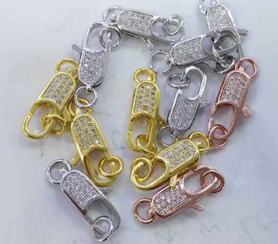 8caad079d428 Collar 12 unids 12-25mm CZ micro Pave diamante pavimentado corchetes de la  langosta de la joyería micro Pave long oval latón conenctor se