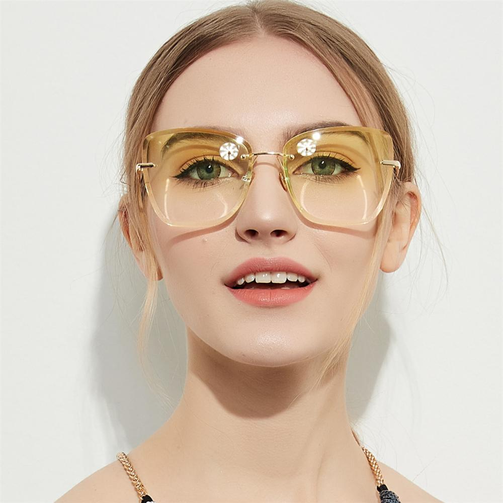 New frameless sunglasses transparent color lens personality wild ladies sunglasses European and American fashion glasses UV400 image