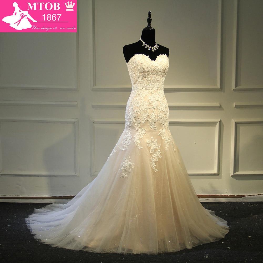 Designer sexy mermaid lace wedding dress shiny beading for Big bling wedding dresses