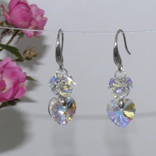 Фото популярные модные разноцветные серьги с кристаллами украшения