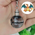 Charizard Novelty Mini Portable Pokemon Go Engraving Round 3D Crystal Glass Ball LED Keychain Colorful Pendant Child Christmas
