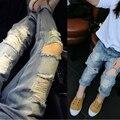 Nuevo 2016 Chicas 2-7Yrs Chicos Vaqueros Niños Pantalones Vaqueros Del Agujero Roto Pantalones Bebé de La Manera Niños Pantalones Niñas Niños Pantalones de Alta Calidad