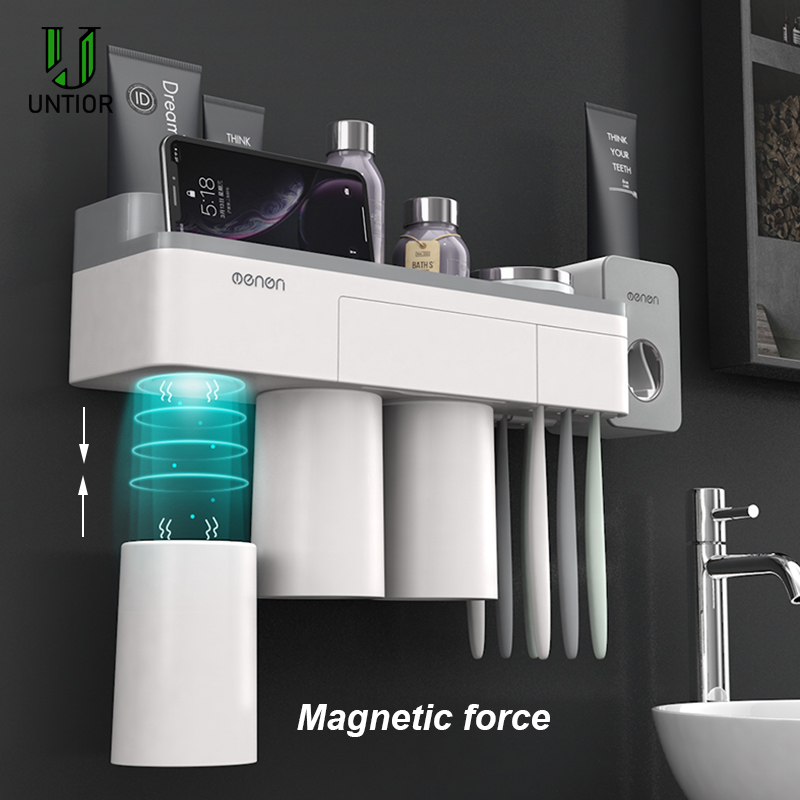 UNITOR Plastic Wall Mounted Toothbrush Holder Automatic Toothpaste Dispenser Toiletries Storage Rack Bathroom Accessories Set image