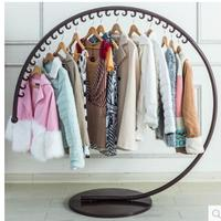 European style iron art clothes hat stand on the floor of a fashion clothing store display rack