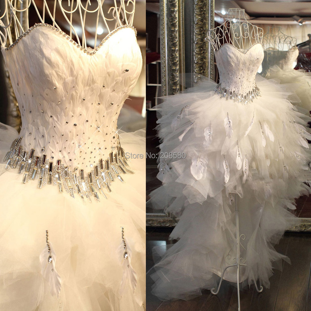 platinum wedding dress with feathers Hailey
