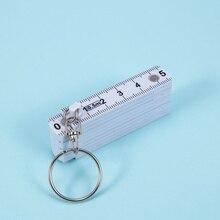 Унисекс Креативный дизайн брелок пластиковая складывающаяся Линейка Рулетка плотник измерительный инструмент 50 см измерительное кольцо для ключей в форме инструмента