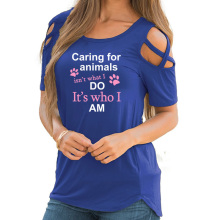 """Caring for animals isn't what i do it's who i am"" women's blouse"