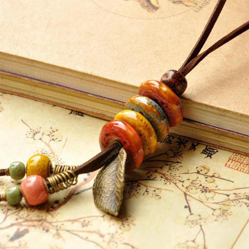 Skórzany naszyjnik ceramiczne wisiorki z koralików liść urok długi łańcuch sweter Strand Choker liście Tassel kobiety mężczyźni biżuteria