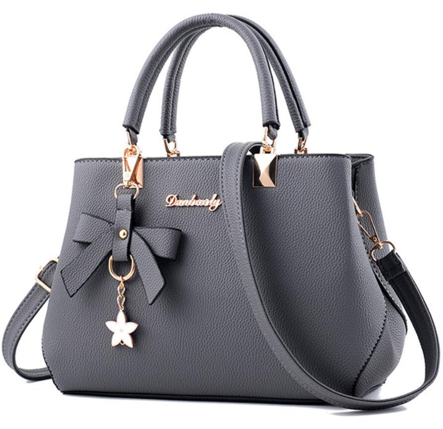 kvinnor hårdvara ornament solida väskor handväska hög kvalitet - Handväskor - Foto 5