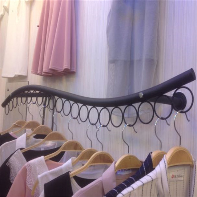 Hang Clothes On Wall clothing display rack wall side hang children's wear clothes rack