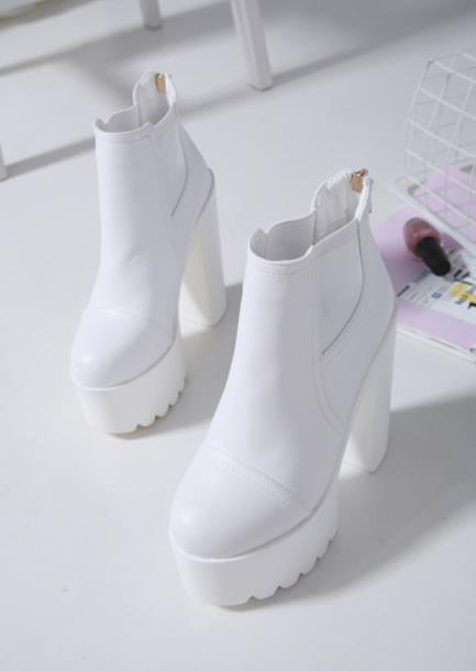 The new European beauty shoe thick heel Martin boots loose cake ultra-high heel waterproof stage performance DS boots boots.The new European beauty shoe thick heel Martin boots loose cake ultra-high heel waterproof stage performance DS boots boots.