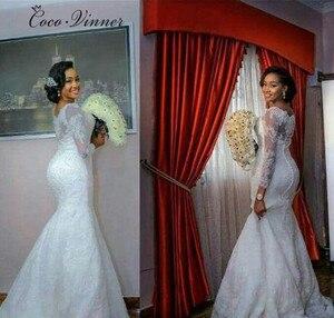 Image 2 - ארוך שרוול תחרת אפליקציות ואגלי אפריקה בת ים חתונת שמלות חדש בתוספת גודל טהור לבן בציר תחרה חתונה שמלת W0257