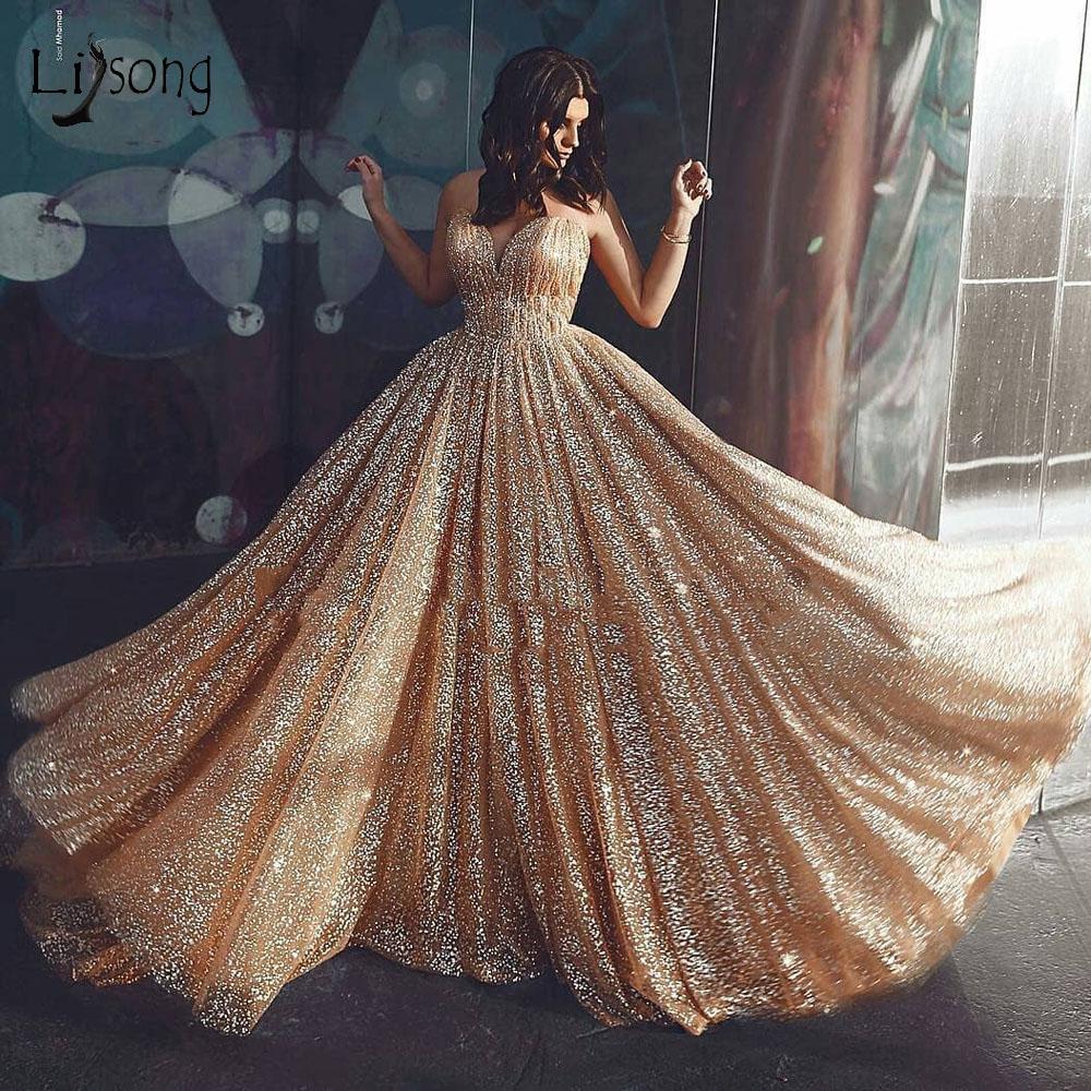 Saudi Arabic Gold A-line Prom Dresses 2019 Sexy Backless Luxury Long Evening Gowns Abiti Da Cerimonia Da Sera Fashion Prom Gowns