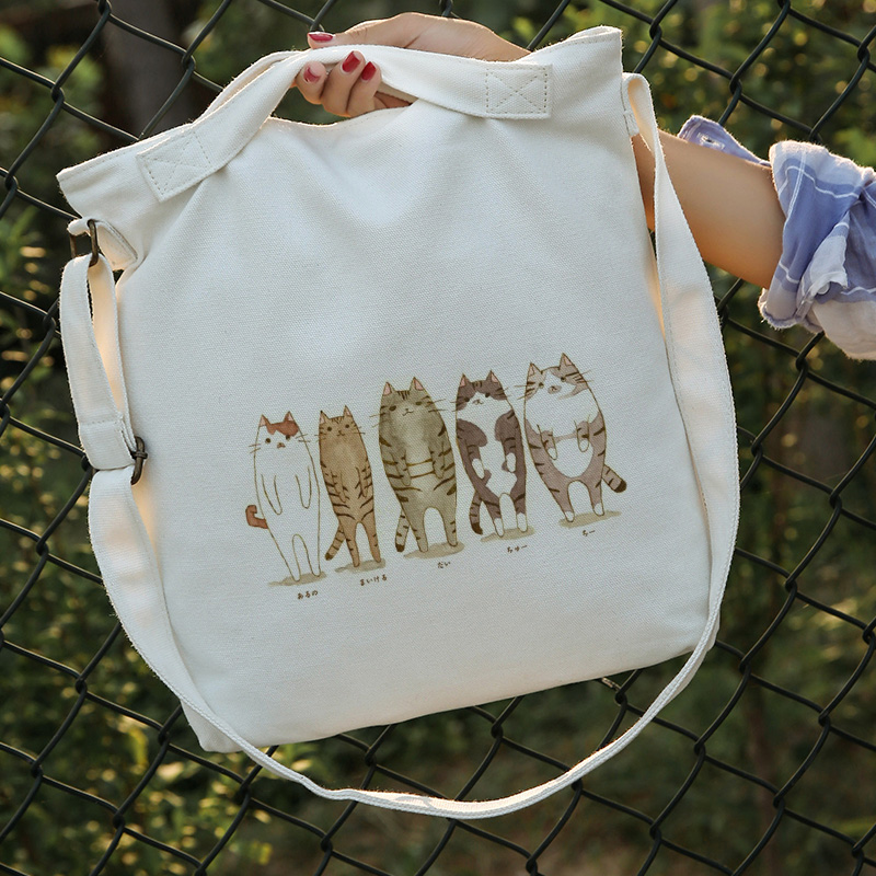 Japan and South Korea women's shoulder bag handbag portable new small fresh cat printing bag simple literary Satchel shopping ba