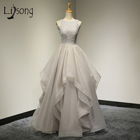 Romantic 2018 Ruffles Bridal Dresses Beaded Long Sexy Wedding Dress Tiered Backless Beach Custom Made Casamento