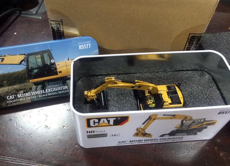 Nueva caja-dm Diecast masters-CAT m318d excavadora de ruedas-ho Básculas-#85177