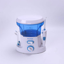 Hot Sales Dental Water Flosser Oral Irrigator for Dental Hygiene & Tooth Care with 7pcs Jet Tip and 600ml Water Tank