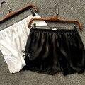 2016 de primavera y Verano de Las Mujeres Pantalones Sueltos pantalones cortos de raso raja del lado del cordón de seda Arco polainas