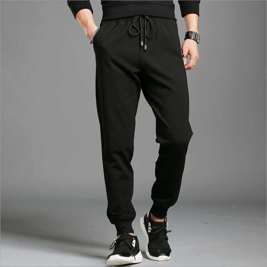 2019 autumn and winter new men's sports casual trousers French brand Slim feet pants Roman nylon badge
