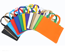 Фотография 30*40*10CM 50pcs  High Quality 13 kinds of Color Non-woven Bag Shopping Bag With Handle Clothes Bags
