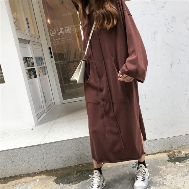 Lange mouwen capuchon jurk