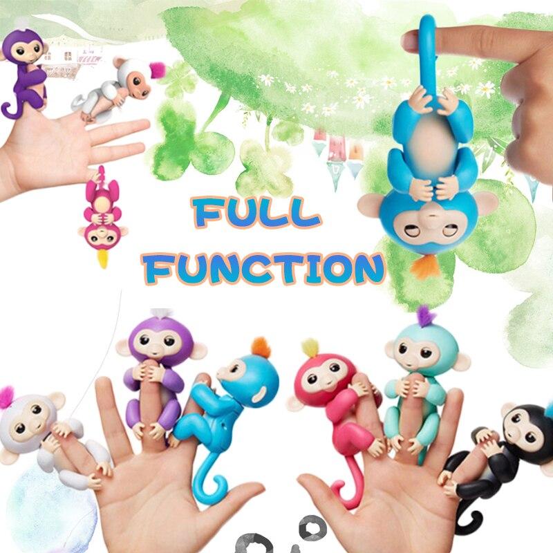 Mono feliz paquete dedo bebé mono Rosa interactivo para el bebé juguete inteligente punta mono inteligente electrónica del dedo mono