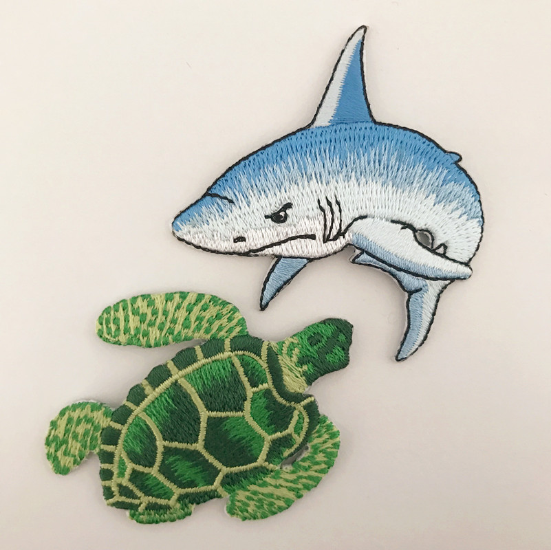 1PC~SMALL SHOPPING FISH~IRON ON EMBROIDERED APPLIQUE
