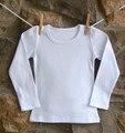 Venta al por menor 18 M a 12 T del bebé y de los niños adolescente niñas moda de manga larga sólido blanco negro 2015 otoño invierno base T camisas camisetas casual