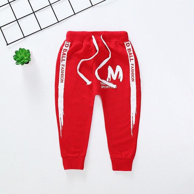 Primavera otoño nuevos pantalones informales para niños Pantalones deportivos a rayas laterales para bebés pantalones largos bordados de algodón