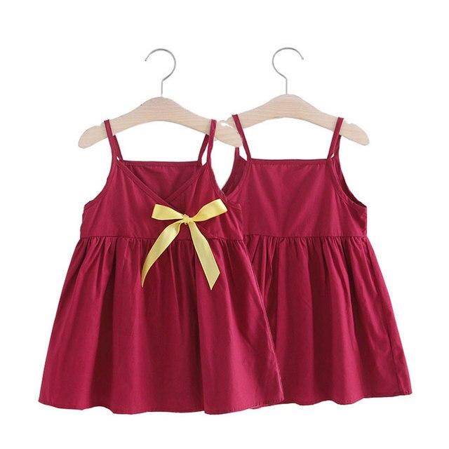 בנות שמלת קיץ בגדים חדשים פיצוץ מוצק צבע שמלת קשת קוריאני תינוק חמוד שמלה