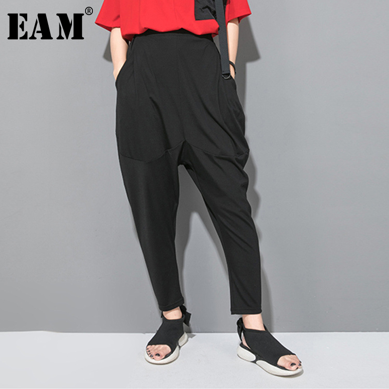[EAM] 2020 New Spring Autumn High Elastic Waist Black Leisure Pocket Stitch Loose Harem Pants Women Trousers Fashion Tide JW997