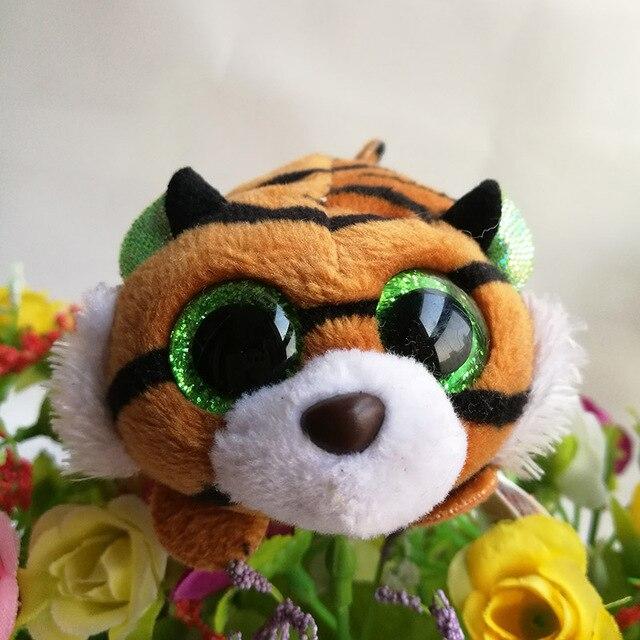 大きい緑色の目をした虎のぬいぐるみ
