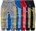 SKZ-304 Frete Grátis 2014 Criança Quadradão Impresso Calças Compridas Menino Da Menina do Algodão Calças Esportivas Crianças Qualidade Superior Outono de Varejo de Vestuário